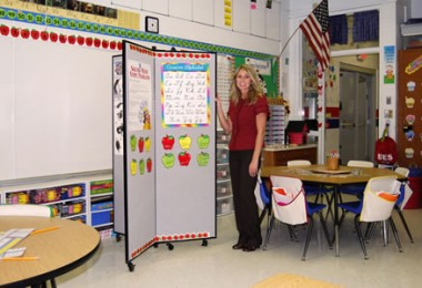 A teacher shows off her mobile display tower in the front of her classroom