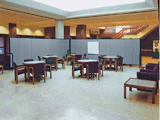 Rolling walls section off a portion of a library lobby to create a meeting area