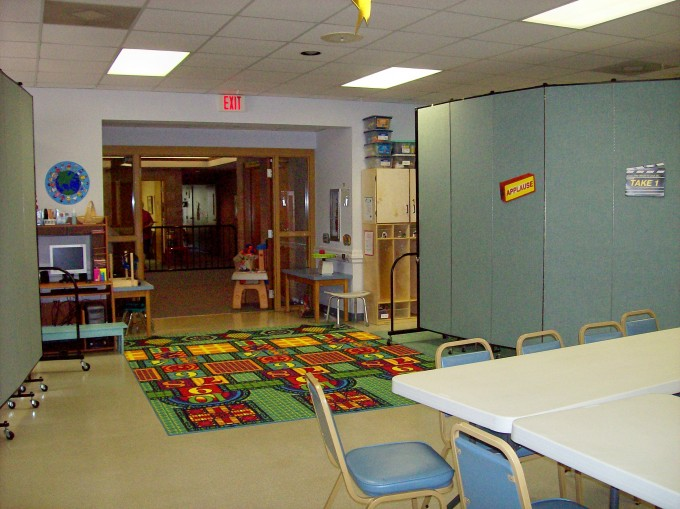 A room divider creates an entryway to a daycare room in a church
