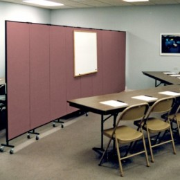 A conference room is split in two to create 2 training rooms