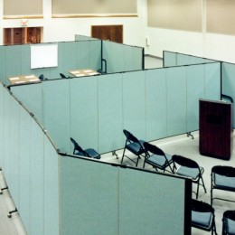 Room dividers arranged to create multiple conference rooms in a large open space