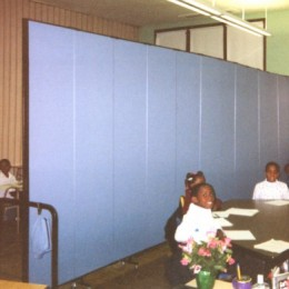 A crowded classroom is divided into two rooms with a Screenflex Room Divider