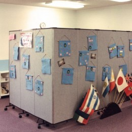 Room divider in an l-shape creates an office in a classroom