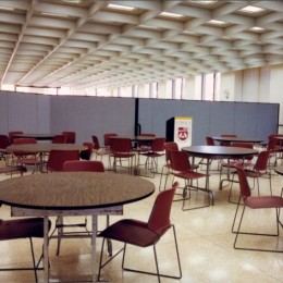A room divider separates dining and conference areas in a student union