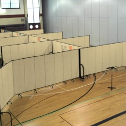 8 classrooms and game area are created iin a gymnasium with Screenflex Room Dividers