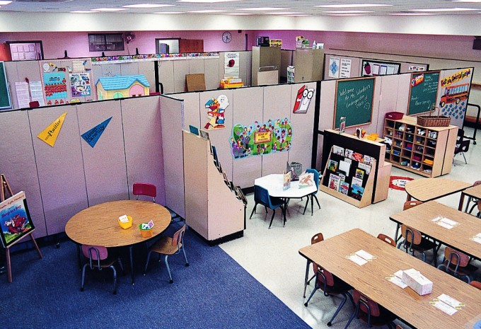 A school converts a large open space into multiple classrooms with Screenflex Room Dividers