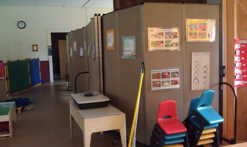 Room dividers create a storage closet in a preschool classroom