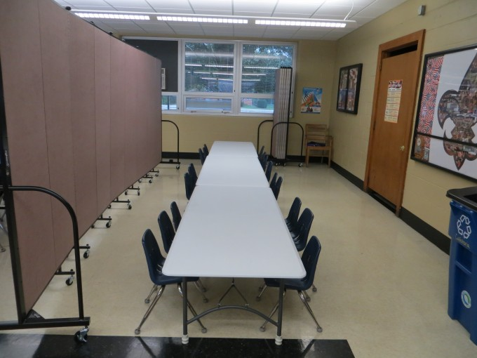 Classroom partitions separate a cafeteria into multiple classrooms