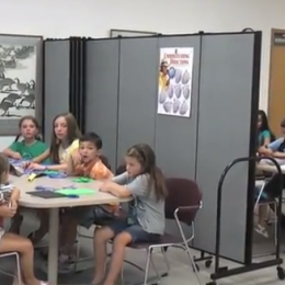 Dividing 2 groups of kids at table twith room dividers