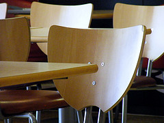 Wooden desks and chairs in the classroom
