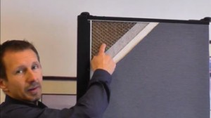 A male points to the inner honeycomb core of a Screenflex Room Divider.