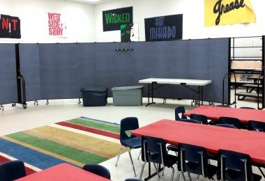 Mobile classroom with portable dividers hiding choir risers