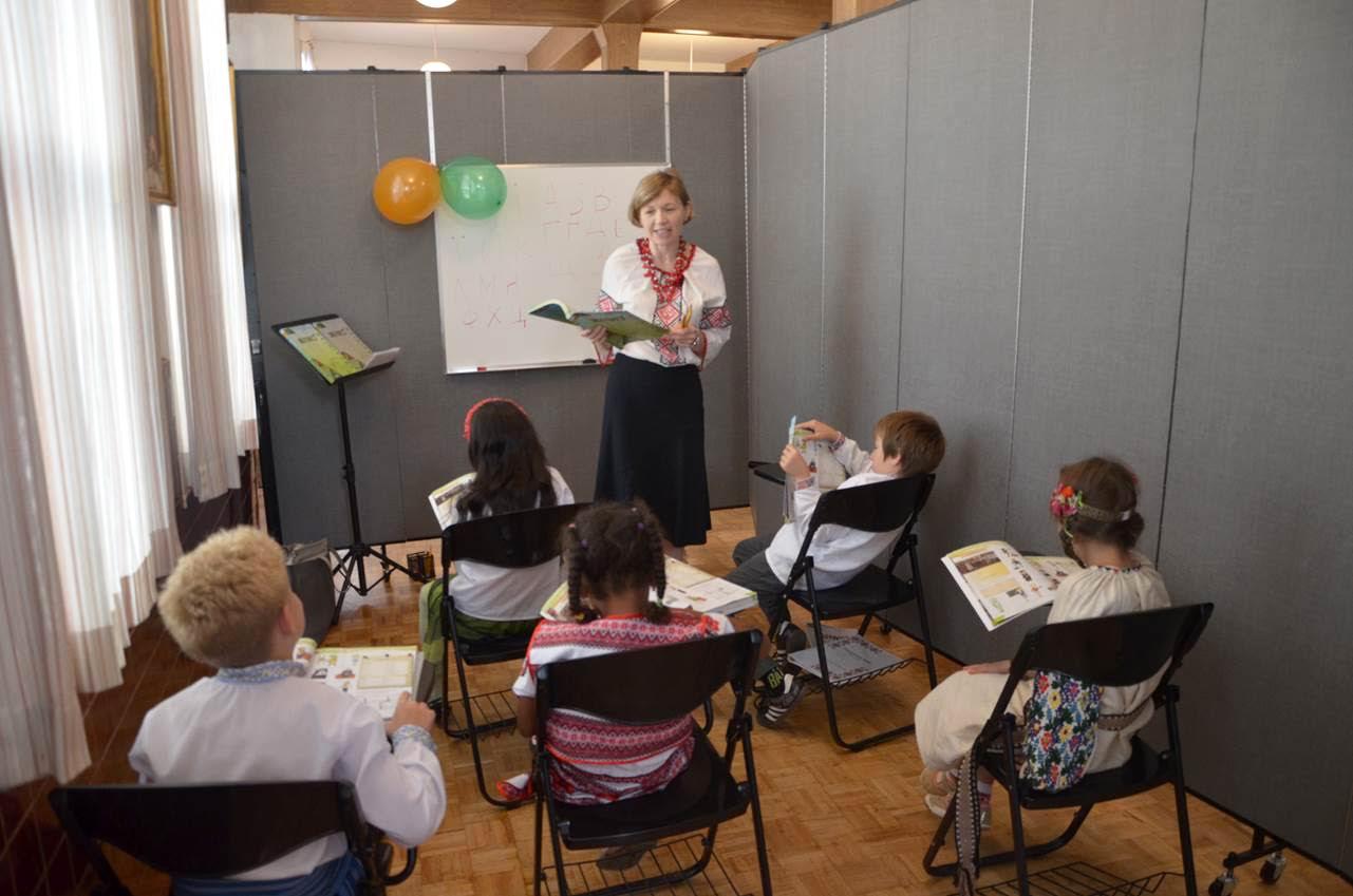 A teacher converses with her class