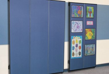 Tackable panels lay flat against the wall when open or folded