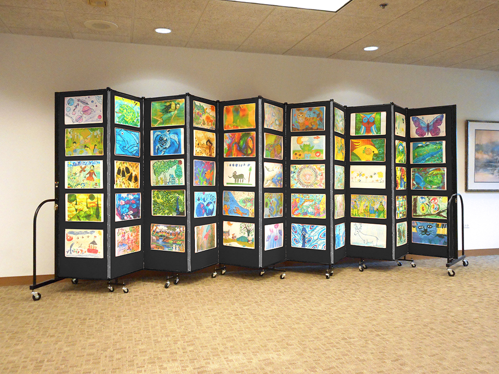Tack, pin or staple artwork to both sides of the portable education art display wall