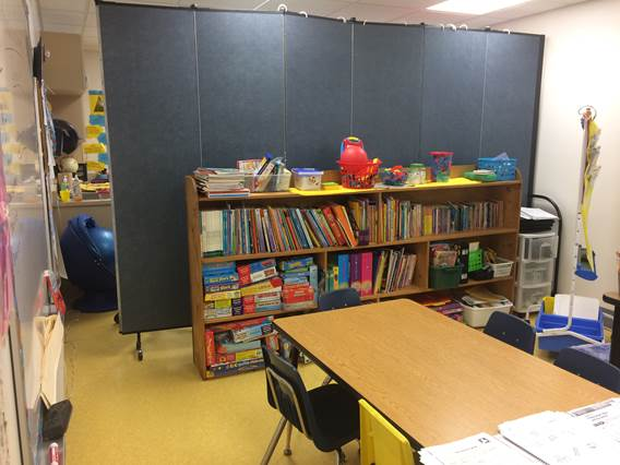 Temporary classroom dividers separates a room in two learning spaces